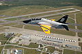 US Navy 101029-N-3951P-001 A T-45 Goshawk training aircraft painted in a pre-World War II tactical aircraft paint scheme flies over Naval Air Stati.jpg