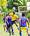 US Navy 110420-O-XX000-002 Seaman Jones Kwaobaffour plays soccer against a Tongan team during a Pacific Partnership 2011 community service event.jpg