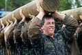 US Navy 110517-N-OA833-007 Plebes carry a modified telephone pole during the log PT station of Sea Trials, the capstone training exercise for Naval.jpg