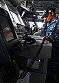 US Navy 110531-N-EE987-016 Ensign Claudia Garcasrios ses an integrated voice user telephone (IVUT) to relay a message to USS Chancellorsville (CG 6.jpg