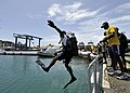 US Navy 110726-N-KB666-242 Inspector Ernest Hanna, a diver assigned to the Royal Bahamas Police Force, conducts a front step entry during diving op.jpg