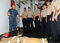 US Navy 110923-N-UE250-106 Damage Controlman 3rd Class Daniel Charlton, left, shows Navy Junior ROTC cadets from Father Duenas Memorial School the.jpg
