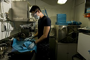 US Navy 111213-N-TZ605-158 Hospital Corpsman 2nd Class Thomas Sorano prepares dental tools for sterilization in the central sterilization room.jpg
