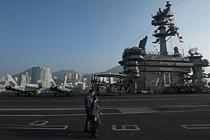 US Navy 111227-N-DR144-097 Sailors transit the flight deck.jpg