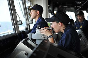 US Navy 111228-N-KS651-127 A Sailor looks through a telescopic alidade in the pilothouse.jpg