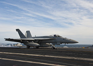 US Navy 120121-N-FI736-165 An F-A-18F Super Hornet assigned to the Thunderbolts of Strike Fighter Squadron (VFA) 136, takes off from the flight dec.jpg