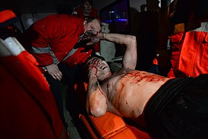 Ukrainian Red Cross Society - Volunteers administering first aid to a wounded Euromaidan protester.