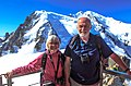 Up Aiguille du Midi - Sanne and Murray against a backdrop of the approaches to Mt Blanc (10975790163).jpg