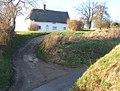 Upper Spring Cottage set above the sunken lane - geograph.org.uk - 672713.jpg