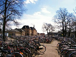 As in many university towns, the bicycle is a common means of transport. Uppsala Central Station in the background to the left.