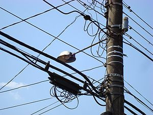 Utility pole shared by service providers