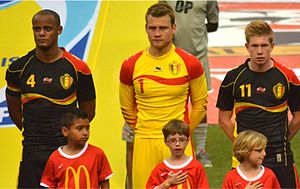 Simon Mignolet - Mignolet (middle) with Belgian teammates Vincent Kompany (left) and Kevin De Bruyne in 2013