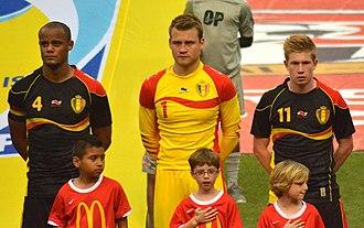 Simon Mignolet - Mignolet (middle) with Belgian teammates Vincent Kompany (left) and Kevin De Bruyne in 2013