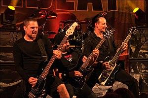 Volbeat - Volbeat performing in Madrid in 2013. L–R: Anders Kjølholm, Rob Caggiano, Jon Larsen (drums), Michael Poulsen
