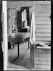 Washstand in the dog run and kitchen of Floyd Burroughs' cabin. Hale County, Alabama LOC 3549662150.jpg