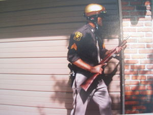 Deadly force - Deputy Sheriff with Reising submachine gun.