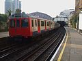 West Brompton stn District line D stock roundel.JPG
