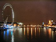 Westminster Bridge and surrounding landmarks at night.