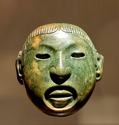 A mask associated with the rituals of the Aztec god Xipe Totec Xipe Totec mask Louvre MH 78-1-60.jpg