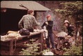 YOUNG CAMPERS AT A STATE LEAN-TO COOK THEIR BREAKFAST BESIDE LAKE TEAR OF THE CLOUDS IN NEW YORK, IN THE ADIRONDACK... - NARA - 554510.tif