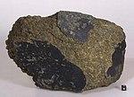Yamato000593-Mars MeteoriteFoundOnEarth-NASA2012.jpg