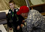 Youths experience mock deployment 150427-F-IT851-143.jpg