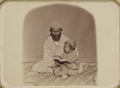 Zeravshan Okrug. First Lessons. A Man with a Young Boy Who is Reading a Book WDL11177.png