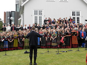 Faroe Islanders - Faroese politicians, priests and choir in front of the Løgting (Parliament), Ólavsøka 2012.