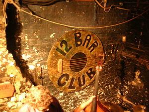 12 Bar Club - The 12 Bar Club logo on the main stage