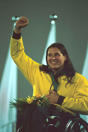 Louise Sauvage - Sauvage shown waving to the crowd whilst on the medal podium at the 2000 Summer Paralympics