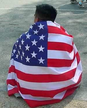Protester at March for America wears an Americ...