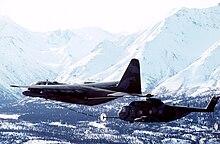 U.S. Air Force 210th Air Rescue Squadron, Alaska Air National Guard, Lockheed HC-130(H)N Hercules aircraft conducts an in flight refueling with a 71st ARS ...