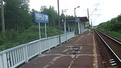 240 km BMO railway platform (sign and roof, view to east).JPG