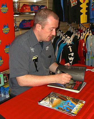 Garth Ennis - Ennis signing copies of Hitman and Preacher at a 19 April 2012 appearance at Midtown Comics Downtown in Manhattan