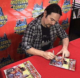 Avengers (comics) - Artist Clayton Crain signing the first issue of the 2018 series at Midtown Comics Downtown in Manhattan