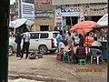 "ASC Leiden - van de Bruinhorst Collection - Somaliland 2019 - 4358 - A street with groups of talking men sitting and standing. A shop ""Baabusalaa"".jpg"