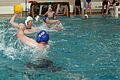 A U.S. Marine with 1st Reconnaissance Battalion prepares to throw a polo ball during a water polo tournament at Al Asad Air Base, Iraq, March 15, 2009 090315-M-KL291-031.jpg