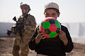 A boy in Ananzai village, Kandahar province, Afghanistan, holds up a soccer ball he received from a U.S. Soldier Dec. 26, 2011 111226-A-VB845-016.jpg