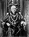 A distinguished gentleman in robes and chain of office sitting on a throne (of sorts) (29905539612).jpg