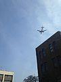 A plane flying over Hakozaki Campus, Kyushu University 20140328.jpg
