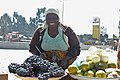 A woman is selling grape and oranges.jpg
