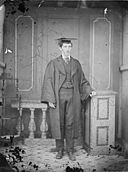 A youn man in academic dress NLW3364666.jpg