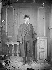 A young man in academic dress