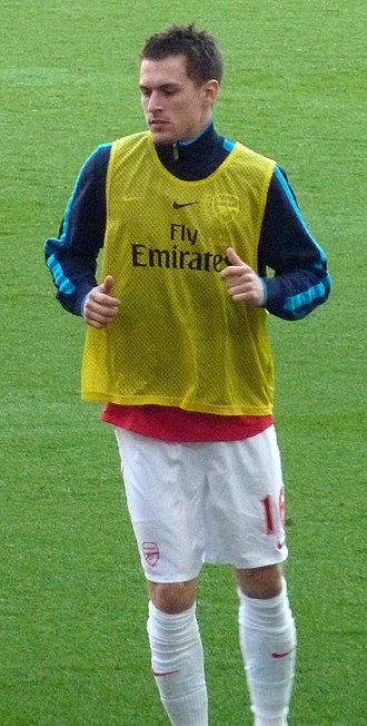 Aaron Ramsey - Ramsey warming up before a match against Aston Villa on 24 March 2012