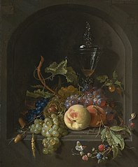 Still life of grapes, peaches, blackberries, acorns, prickly fruit, an elaborate glass and various insects on a ledge in a niche