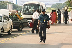 Aetos Security Management - An Aetos auxiliary police officer stationed outside the Departure Hall of Terminal 2, Singapore Changi Airport