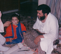 Ahmed Khadr and Maha Elsamnah feeding youngest daughter.png