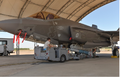 Airmen load a missile on an F-35.png