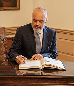 Albanian Prime Minister Edi Rama signs the guest book, at the Department of State in Washington, D.C. (February 5, 2020 - cropped).jpg