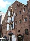 foto van Dubbel pakhuis met trapeziumgevel